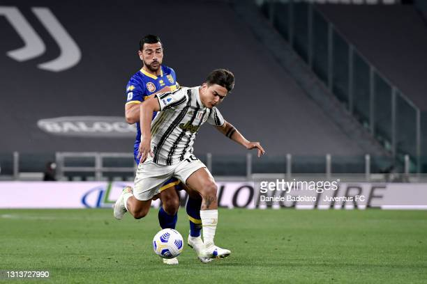 Paulo Dybala of Juventus competes for the ball with Graziano Pellè of Parma Calcio during the Serie A match between Juventus and Parma Calcio at...