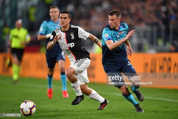 Paulo Dybala of Juventus competes for the ball with Hans Hateboer of Atalanta BC during the Serie A match between Juventus and Atalanta BC on May 19...