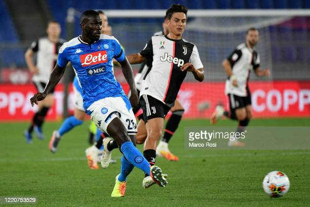 Paulo Dybala of Juventus competes for the ball with Kalidou Koulibaly of SSC Napoli during the Coppa Italia Final match between Juventus and SSC...
