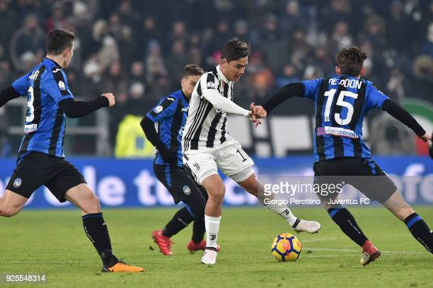 Paulo Dybala of Juventus competes for the ball with Marten de Roon of Atalanta BC during the TIM Cup match between Juventus and Atalanta BC at...