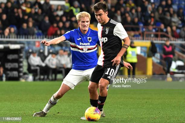 Paulo Dybala of Juventus competes for the ball with Morten Thorsby of UC Sampdoria during the Serie A match between UC Sampdoria and Juventus at...