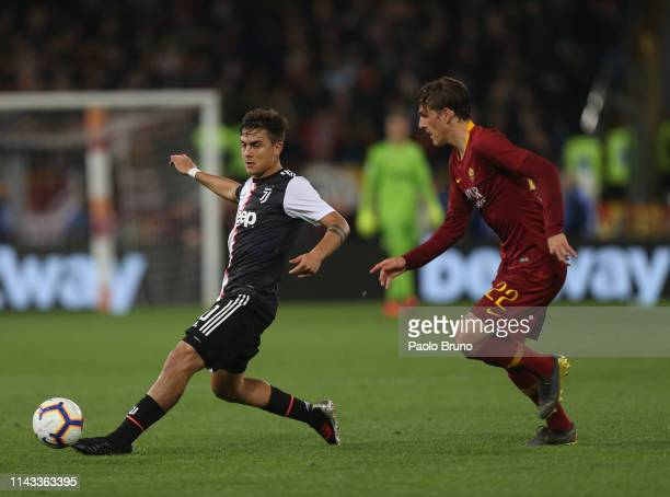 Paulo Dybala of Juventus competes for the ball with Nicolo' Zaniolo of AS Roma during the Serie A match between AS Roma and Juventus at Stadio...