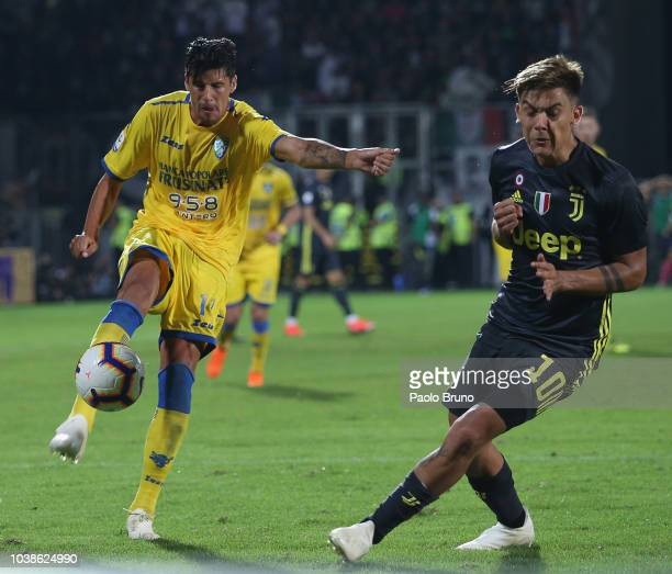 Paulo Dybala of Juventus competes for the ball with Stipe Perica of Frosinone Calcio during the serie A match between Frosinone Calcio and Juventus...