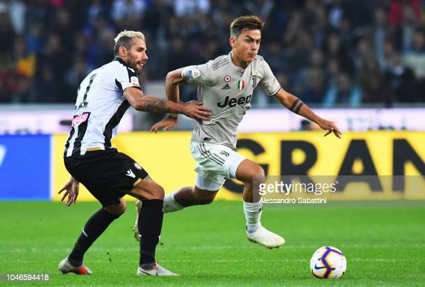 Paulo Dybala of Juventus competes for the ball with Valon Behrami of Udinese Calcio during the Serie A match between Udinese and Juventus at Stadio...