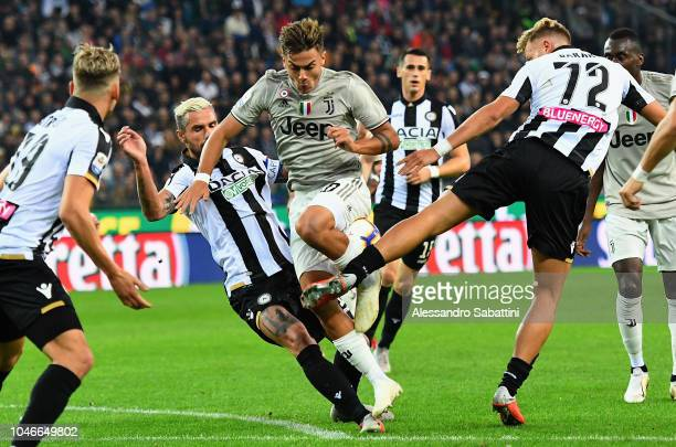 Paulo Dybala of Juventus competes for the ball with Valon Behrami of Udinese Calcio and Antonin Barak of Udinese Calcio during the Serie A match...