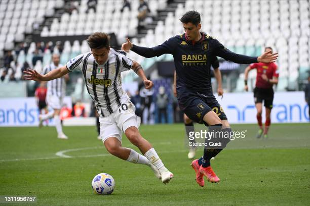 Paulo Dybala of Juventus FC against Filippo Melegoni of Genoa CFC during the Serie A match between Juventus and Genoa CFC at Allianz Stadium on April...