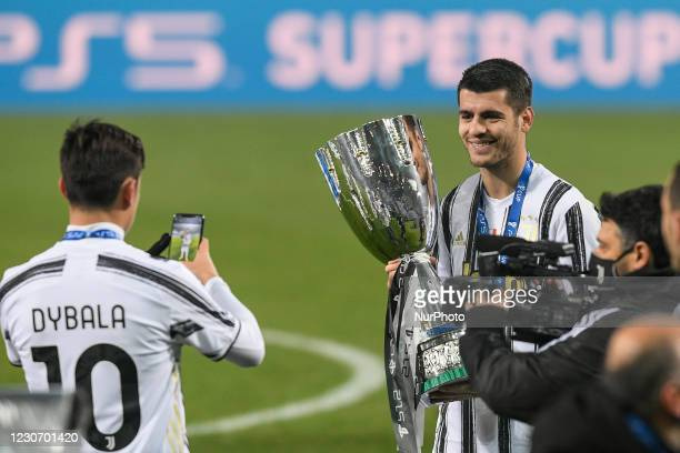 Paulo Dybala of Juventus FC and Alvaro Morata of Juventus FC celebrate after winning the Italian Super Cup Final match between FC Juventus and SSC...
