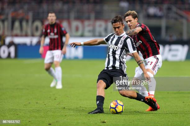Paulo Dybala of Juventus FC and Lucas Biglia of Ac Milan in action during the Serie A football match between Ac Milan and Juventus Fc Juventus Fc...