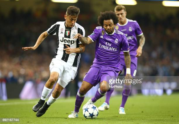 LR Paulo Dybala of Juventus FC and Marcelo of Real Madrid CF during the UEFA Champions League Final match between Real Madrid and Juventus at...