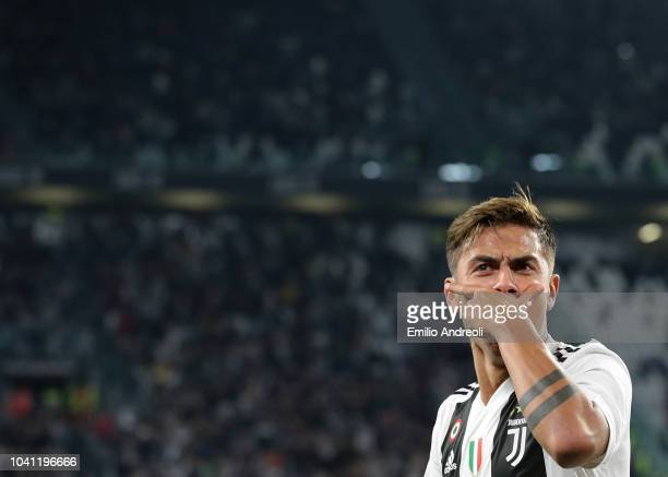 Paulo Dybala of Juventus FC celebrates after scoring the opening goal during the Serie A match between Juventus and Bologna FC at Allianz Stadium on...