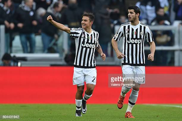 Paulo Dybala of Juventus FC celebrates after scoring the opening goal with team mate Alvaro Morata during the Serie A match between Juventus FC and...