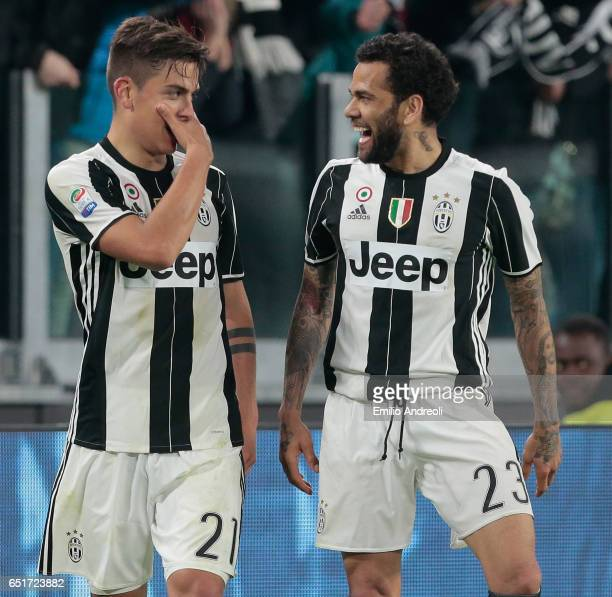 Paulo Dybala of Juventus FC celebrates his goal with his teammate Daniel Alves da Silva during the Serie A match between Juventus FC and AC Milan at...
