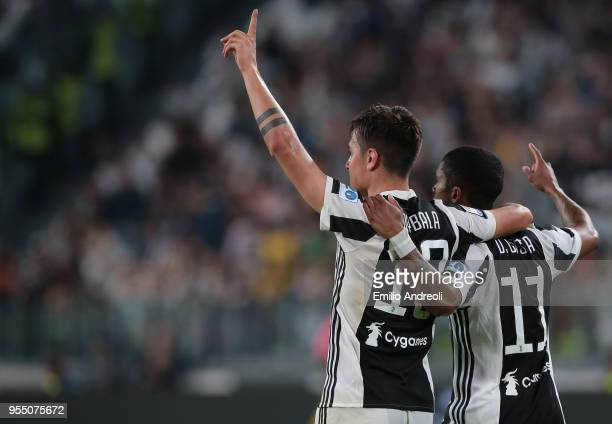 Paulo Dybala of Juventus FC celebrates his goal with his teammate Douglas Costa during the serie A match between Juventus and Bologna FC at Allianz...