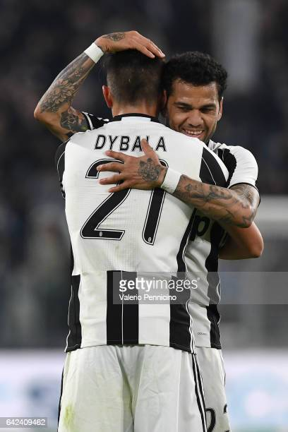 Paulo Dybala of Juventus FC celebrates his goal with team mate Daniel Alves during the Serie A match between Juventus FC and US Citta di Palermo at...