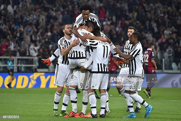 Paulo Dybala of Juventus FC celebrates his goal with team mates during the Serie A match between Juventus FC and Bologna FC at Juventus Arena on...