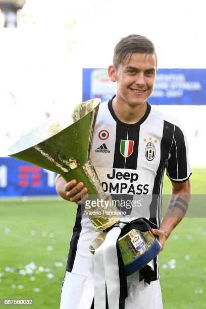 Paulo Dybala of Juventus FC celebrates with the trophy after the beating FC Crotone 30 to win the Serie A Championships at the end of the Serie A...