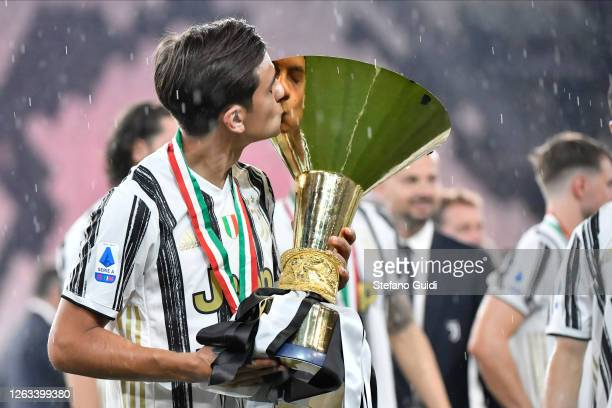 Paulo Dybala of Juventus FC celebrates with the trophy after winning the Serie A Championship 20192020 during the Serie A match between Juventus and...