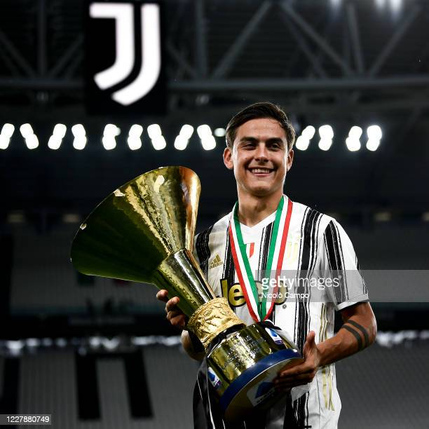 Paulo Dybala of Juventus FC celebrates with the trophy during the award ceremony for Serie A 20192020 title at end of the Serie A football match...
