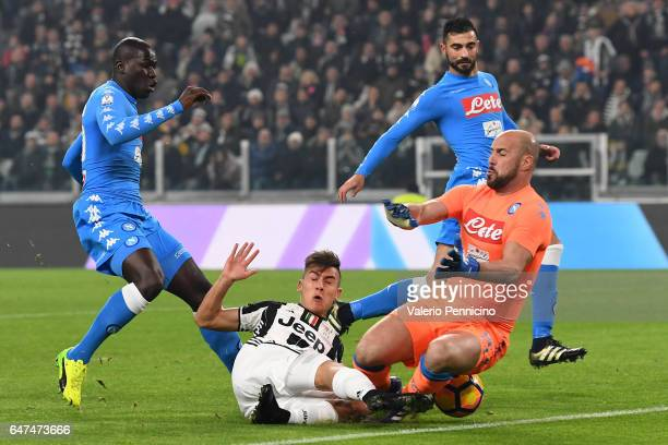 Paulo Dybala of Juventus FC clashes with Jose Manuel Reina of SSC Napoli during the TIM Cup match between Juventus FC and SSC Napoli at Juventus...