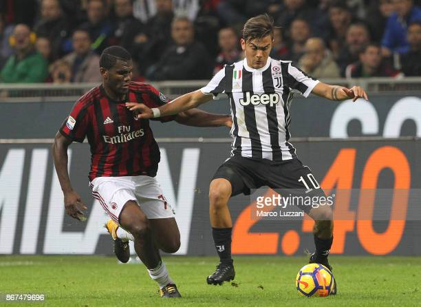 Paulo Dybala of Juventus FC competes for the ball with Franck Kessie of AC Milan during the Serie A match between AC Milan and Juventus at Stadio...