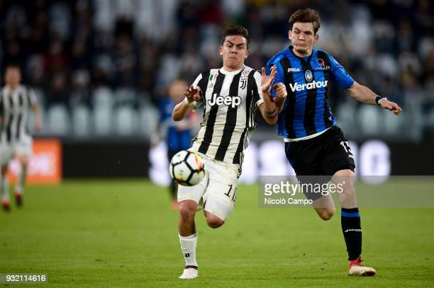 Paulo Dybala of Juventus FC competes for the ball with Marten de Roon of Atalanta BC during the Serie A football match between Juventus FC and...