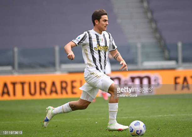 Paulo Dybala of Juventus FC controls the ball during the Serie A match between Juventus and Genoa CFC at Allianz Stadium on April 11, 2021 in Turin,...