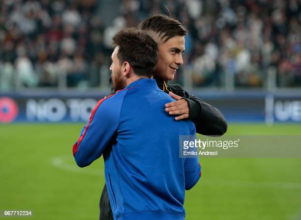 Paulo Dybala of Juventus FC embraces Lionel Messi of FC Barcelona prior to the UEFA Champions League Quarter Final first leg match between Juventus...