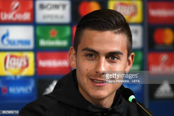 Paulo Dybala of Juventus FC faces the media during a press conference ahead of the UEFA Champions League Round of 16 second leg match between...