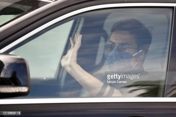 Paulo Dybala of Juventus FC gestures as he arrives by car to the Continassa training ground to attend a training session Serie A plans to resume its...