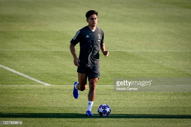 Paulo Dybala of Juventus FC in action during Juventus FC training on the eve of the UEFA Champions League round of 16 second leg football match...