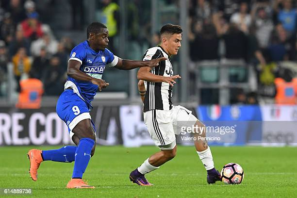 Paulo Dybala of Juventus FC is challenged by Duvan Zapata of Udinese Calcio during the Serie A match between Juventus FC and Udinese Calcio at...