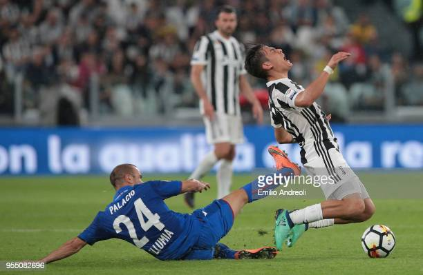 Paulo Dybala of Juventus FC is challenged by Rodrigo Palacio of Bologna FC during the serie A match between Juventus and Bologna FC at Allianz...