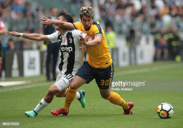 Paulo Dybala of Juventus FC is challenged by Ryder Matos of Hellas Verona during the serie A match between Juventus and Hellas Verona FC at Allianz...