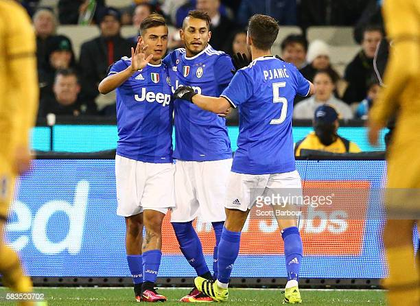Paulo Dybala of Juventus FC is congratulated by Miralem Pjanic and his teammates after scoring a goal during the 2016 International Champions Cup...