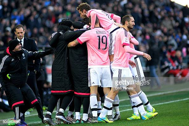 Paulo Dybala of Juventus FC is mobbed by team mates after scoring his team's opening goal during the Serie A match between Udinese Calcio and...
