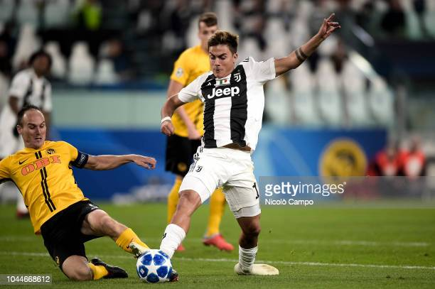 Paulo Dybala of Juventus FC is tackled by Steve von Bergen of BSC Young Boys during the UEFA Champions League football match between Juventus FC and...