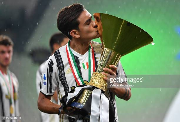 Paulo Dybala of Juventus FC kisses the trophy after the Serie A match between Juventus and AS Roma at Allianz Stadium on August 1 2020 in Turin Italy