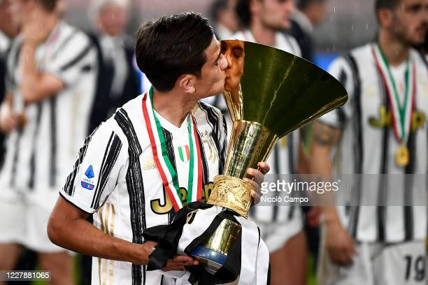 Paulo Dybala of Juventus FC kisses the trophy during the award ceremony for Serie A 20192020 title at end of the Serie A football match between...