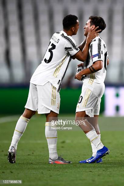 Paulo Dybala of Juventus FC looks dejected after suffering an injury as Danilo Luiz da Silva of Juventus FC consoles him during the UEFA Champions...