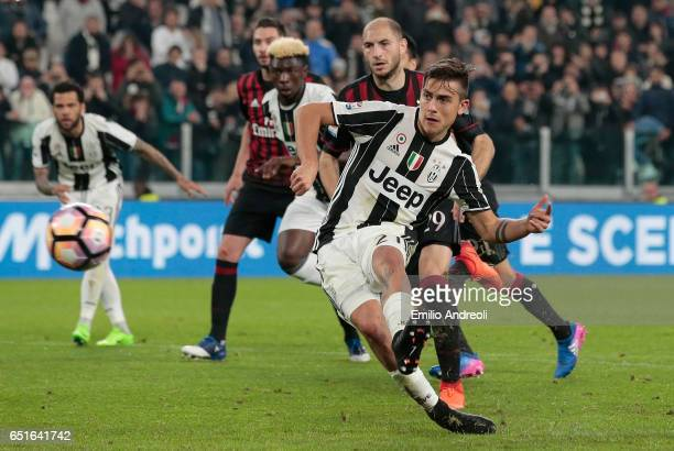Paulo Dybala of Juventus FC scores his goal from the penalty spot during the Serie A match between Juventus FC and AC Milan at Juventus Stadium on...