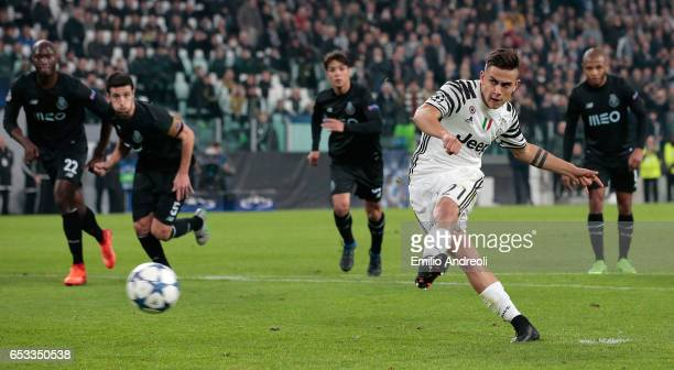Paulo Dybala of Juventus FC scores his goal from the penalty spot during the UEFA Champions League Round of 16 second leg match between Juventus and...