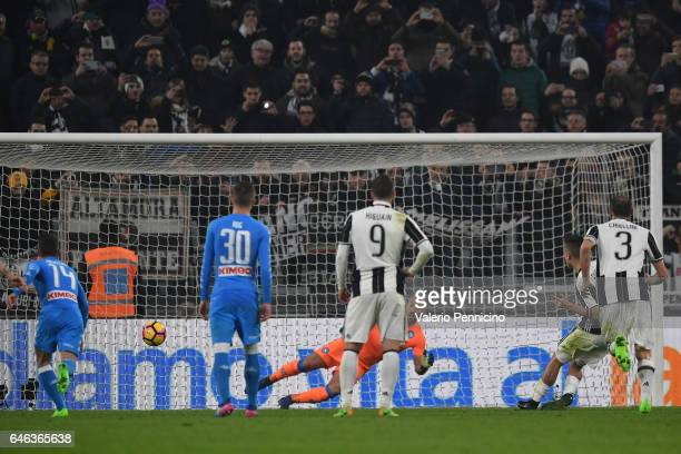 Paulo Dybala of Juventus FC scores his second goal from the penalty spot during the TIM Cup match between Juventus FC and SSC Napoli at Juventus...