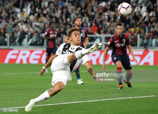 Paulo Dybala of Juventus FC scores the opening goal during the Serie A match between Juventus and Bologna FC at Allianz Stadium on September 26 2018...
