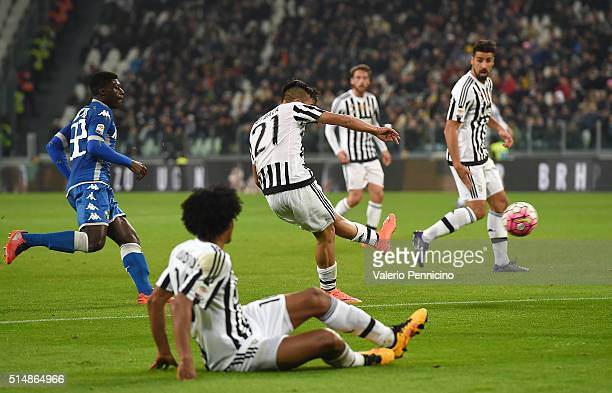 Paulo Dybala of Juventus FC scores the opening goal during the Serie A match between Juventus FC and US Sassuolo Calcio at Juventus Arena on March 11...