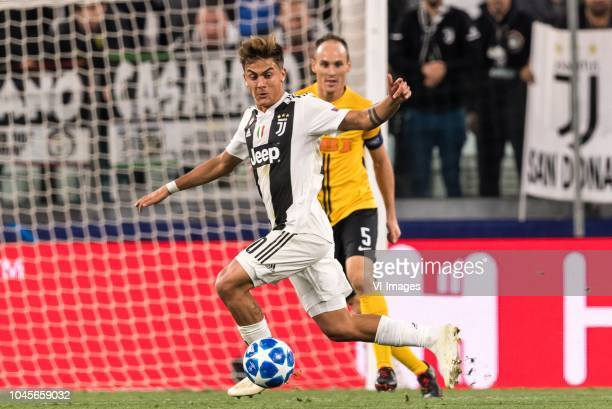 Paulo Dybala of Juventus FC Steve von Bergen of BSC Young Boys during the UEFA Champions League group H match between Juventus FC and Young Boys at...