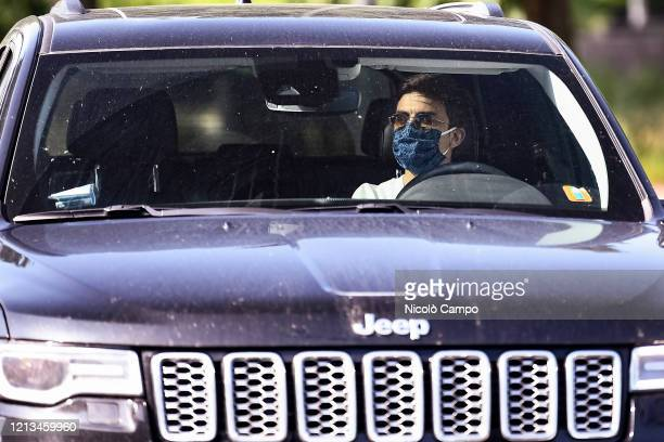 Paulo Dybala of Juventus FC wearing a face mask arrives by car to the Continassa training ground to attend a training session Serie A plans to resume...