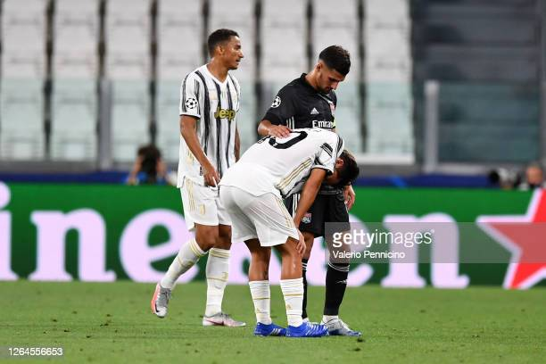Paulo Dybala of Juventus goes down injured during the UEFA Champions League round of 16 second leg match between Juventus and Olympique Lyon at...