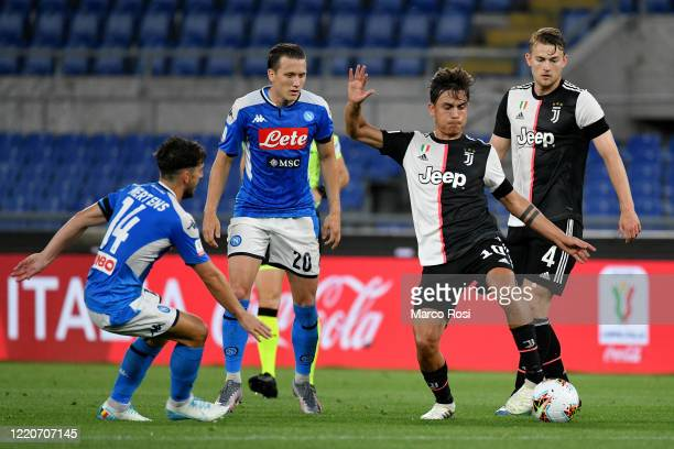 Paulo Dybala of Juventus in action between Dries Mertens and Piotr Zielinski of SSC Napoli during the Coppa Italia Final match between Juventus and...