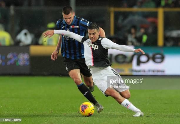 Paulo Dybala of Juventus is challenged by Berat Djimsiti of Atalanta BC during the Serie A match between Atalanta BC and Juventus at Gewiss Stadium...