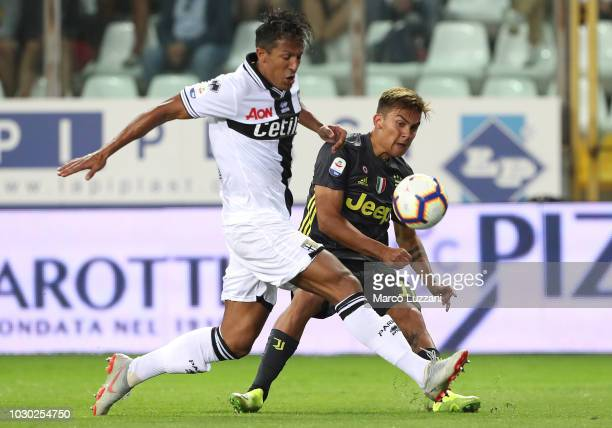 Paulo Dybala of Juventus is challenged by Bruno Alves of Parma Calcio during the serie A match between Parma Calcio and Juventus at Stadio Ennio...